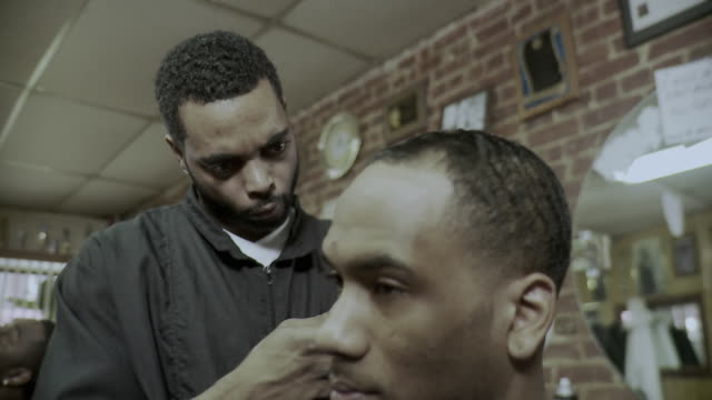ms selective focus barber cutting man's hair in barber shop, brooklyn, new york city, new york state, usa - see other clips from this shoot 1437 stock videos and b-roll footage