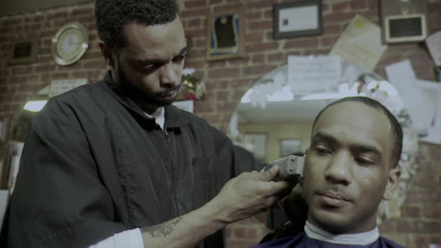 ms barber cutting man's hair in barber shop, brooklyn, new york city, new york state, usa - see other clips from this shoot 1437 stock videos and b-roll footage