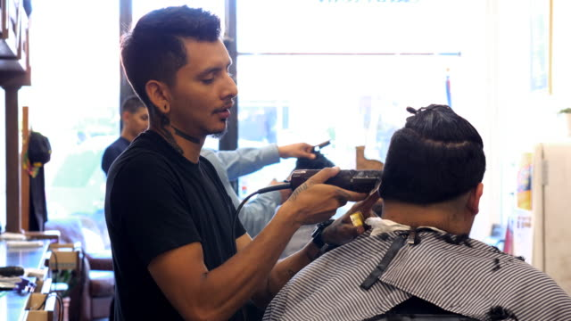 ms barber cutting mans hair with trimmer in shop - hair clipper stock videos & royalty-free footage