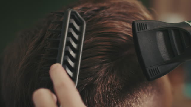 barber drying hair with hair blower - movember stock videos & royalty-free footage
