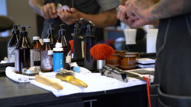 barber examining various tools in hair salon - barber stock videos & royalty-free footage