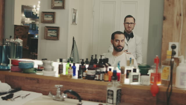 barber finishing haircut - movember stock videos & royalty-free footage