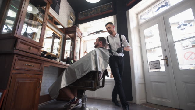barber finishing shaving customer beard - barber chair stock videos & royalty-free footage