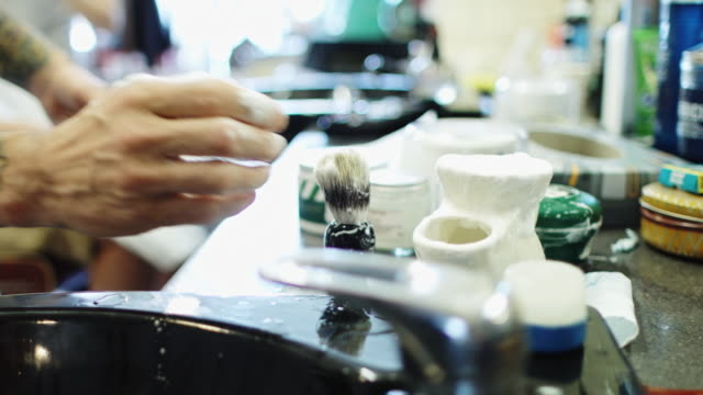 barber getting equipment ready - shaving brush stock videos & royalty-free footage