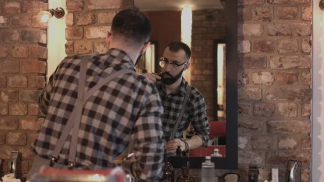 barber in barbershop grooming himself - beauty salon stock videos and b-roll footage