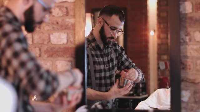 barber in barbershop preparing shaving cream - shaving brush stock videos & royalty-free footage