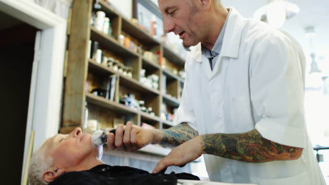 barber lathering client's face - shaving brush stock videos & royalty-free footage
