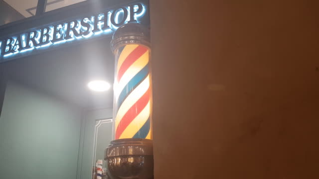 barber light at front door barber shop at night - mirror object stock videos & royalty-free footage