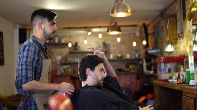 barber listening clients request for his beard and haircut - beauty salon stock videos and b-roll footage