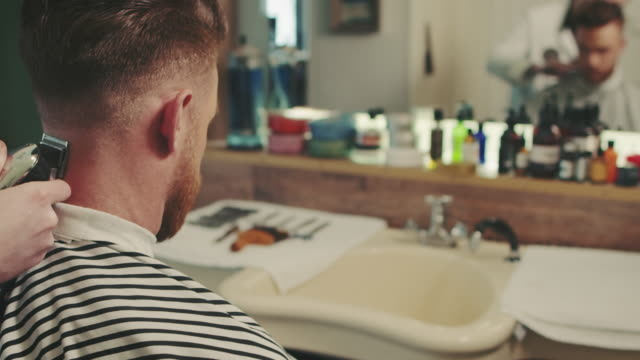 barber making haircut with clipper - movember stock videos & royalty-free footage