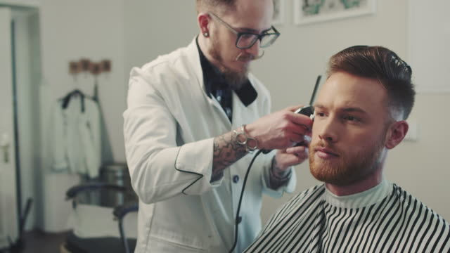 Barber making haircut with clipper