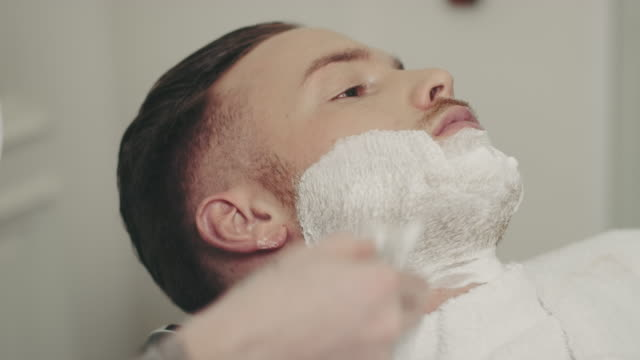 Barber preparing beard