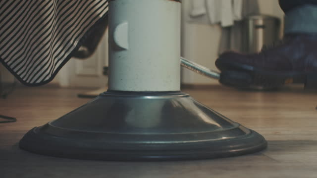 barber pumping dressing stool up - movember stock videos & royalty-free footage