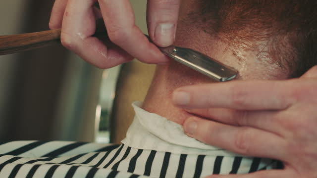 barber shaving beard with razor - movember stock videos & royalty-free footage