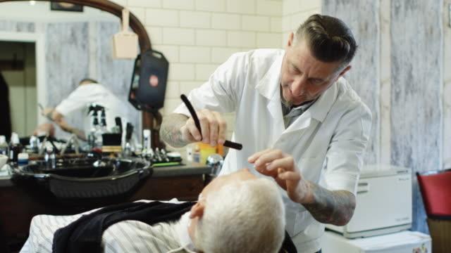 barber shaving customer's top lip - shaving brush stock videos & royalty-free footage
