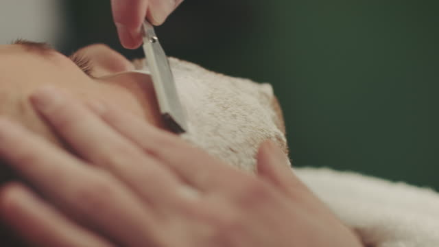 barber shaving mans beard - sharp stock videos and b-roll footage