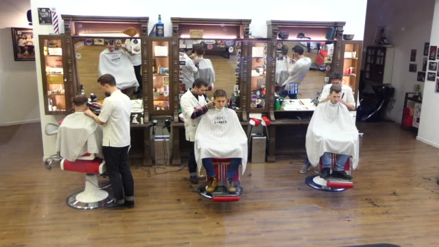 barber shop in kiev, ukraine - barber stock videos & royalty-free footage