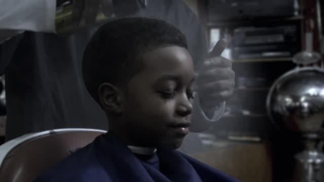 cu zo ms frozen, barber spraying boy's (8-9) hair with hairspray, brooklyn, new york, usa - hair spray stock videos & royalty-free footage