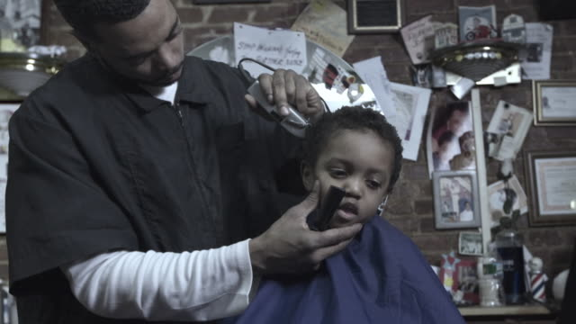 ms zi cu frozen, barber trimming boy's (2-3) hair, brooklyn, new york, usa - see other clips from this shoot 1437 stock videos and b-roll footage