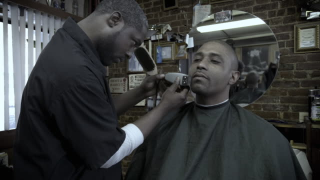 ms zi cu frozen, barber trimming client's facial hair, brooklyn, new york, usa - see other clips from this shoot 1437 stock videos and b-roll footage