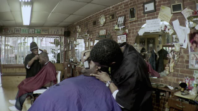 ms barber trimming customer's facial hair, brooklyn, new york city, new york state, usa - dreadlocks stock videos & royalty-free footage