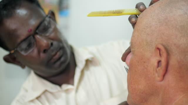 Barber trims mans nasal hair