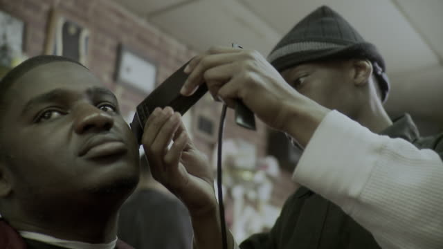 cu r/f barber using clippers shaving customer's facial hair at barbershop, brooklyn, new york city, new york state, usa - see other clips from this shoot 1437 stock videos and b-roll footage