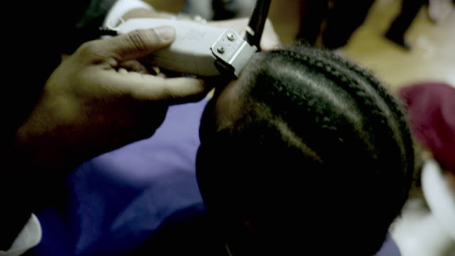 cu ha barber using clippers trimming customer's hair at barbershop, brooklyn, new york city, new york state, usa - black hair stock videos & royalty-free footage