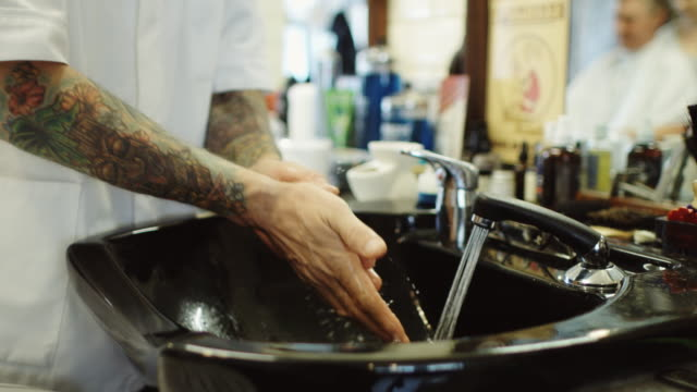 barber washing hands - beauty salon stock videos and b-roll footage
