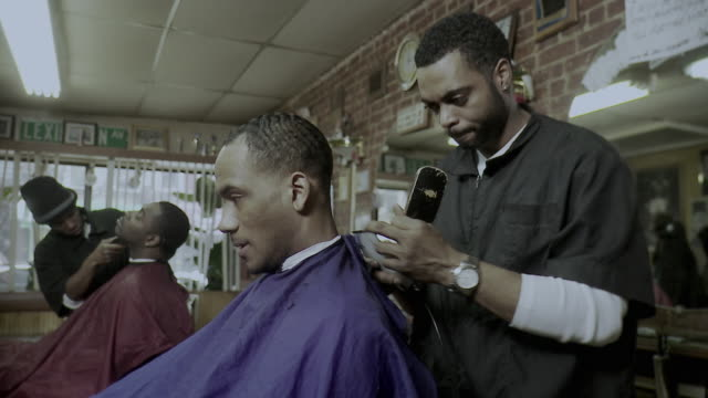 ms barbers cutting client's hair in barber shop, brooklyn, new york city, new york state, usa, pan - barber stock videos & royalty-free footage