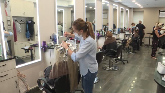 barbershops and hair salons in new york welcomed customers for the first time since midmarch as the city entered the second phase of the gradual... - mid distance stock videos & royalty-free footage