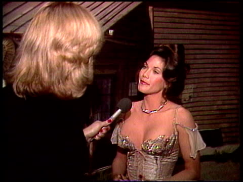 vídeos de stock e filmes b-roll de barbi benton, accompanied by husband george gradow, talks about how good the experience was dating hugh hefner and posing for playboy barbi benton... - 1981