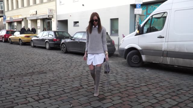 barbora ondrackova wearing a grey knit topshop, a white button shirt all saints, beige stuart weitzman boots, a ysl bag, celine sunglasses on january... - saint laurent stock videos & royalty-free footage