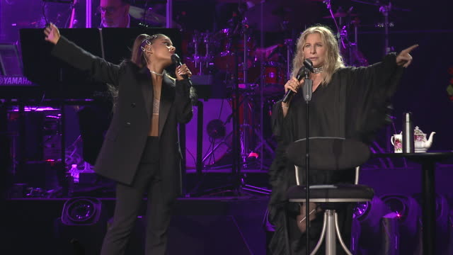 """vídeos de stock e filmes b-roll de barbra streisand and ariana grande performed """"no more tears"""" the 1979 hit song recorded as a duet by barbra streisand and donna summer from the album... - ariana grande"""