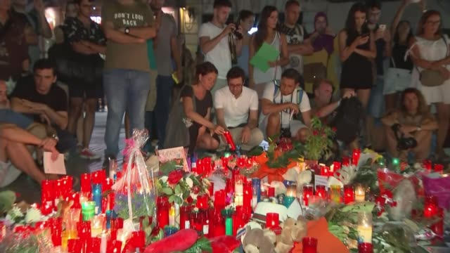 barcelona and cambrils attacks: tributes to victims; barcelona: ext / night various of people looking at lit candles and floral tributes on las... - cambrils stock videos & royalty-free footage