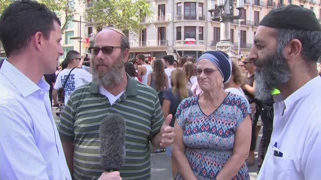 barcelona and cambrils attacks: tributes to victims; las ramblas: jewish man and muslim man stand chatting on las ramblas/ greg bloom interview sot/... - cambrils stock videos & royalty-free footage