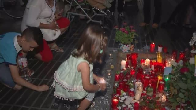 father of missing child searches for son / spanish royals visit victims spain california barcelona general view floral tributes and candles young... - itv weekend late news点の映像素材/bロール