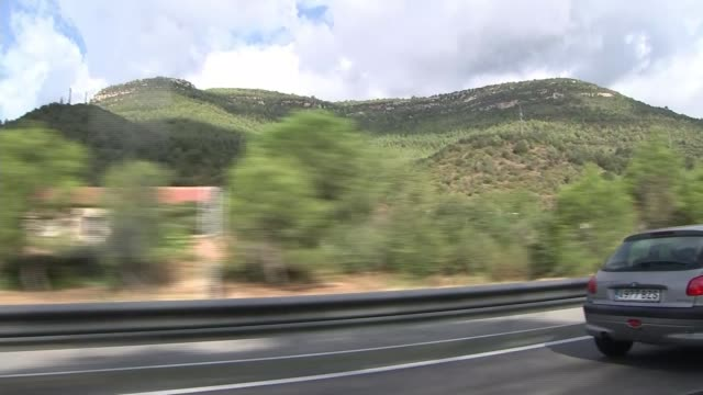 vidéos et rushes de van driver younes abouyaaqoub shot and killed by spanish police spain catalonia view along road past mountain passenger point of view road sign... - car point of view