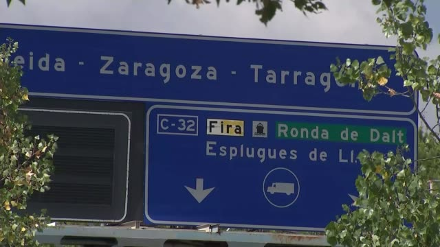 Van driver Younes Abouyaaqoub shot and killed by Spanish police SPAIN Barcelona EXT Flags at half mast 'Zaragoza' road sign Cars along road Motorbike...