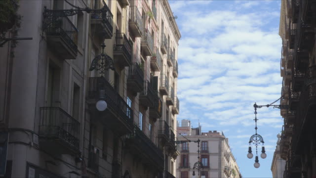 Barcelona buildings establishing shot. Old style street lamp at old town. Calm feelings with the blue sky at early morning