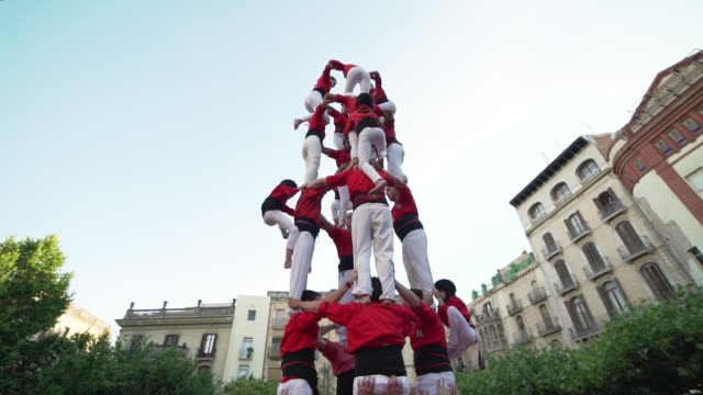 barcelona castellers human pyramid teamwork - pyramid stock videos and b-roll footage