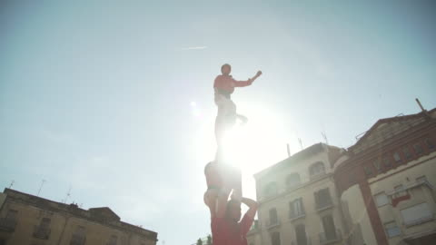 barcelona castellers human pyramid teamwork - support stock videos & royalty-free footage