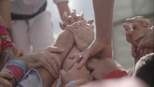 barcelona castellers human pyramid teamwork - human pyramid stock videos and b-roll footage