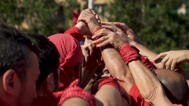 barcelona castellers preparing human tower - pyramid stock videos and b-roll footage