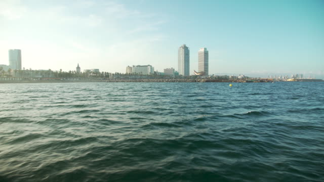 barcelona coast from a boat - boat point of view stock videos & royalty-free footage