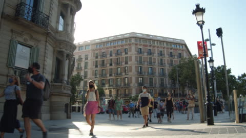 barcelona during covid-19 crisis summer 2020. people wearing masks at paseo de gracia commercial boulevard - pedestrian zone stock videos & royalty-free footage