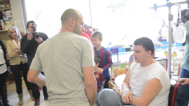 barcelona football club players neymar jr javier mascherano ivan rakitic and munir el haddadi visit the childern's ward at 'hospital sant joan de... - neymar da silva stock-videos und b-roll-filmmaterial