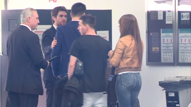 barcelona football player leo messi and his girlfriend antonella rocuzzo are seen at airport to travel to zurich to attend golden ball gala - girlfriend stock videos & royalty-free footage