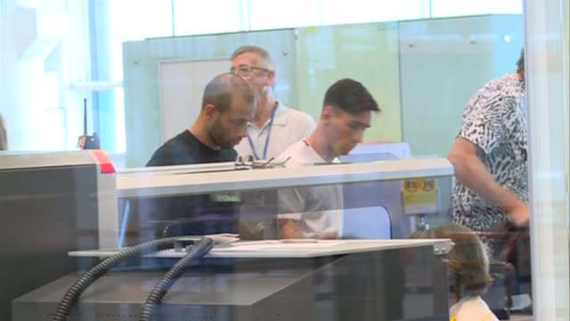 barcelona football players leo messi and javier mascherano arrive to barcelona airport - lionel messi stock videos and b-roll footage