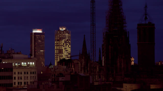 L/S Barcelona, gothic cathedral skyline at dusk-night, towers Mapfre and Hotel Arts